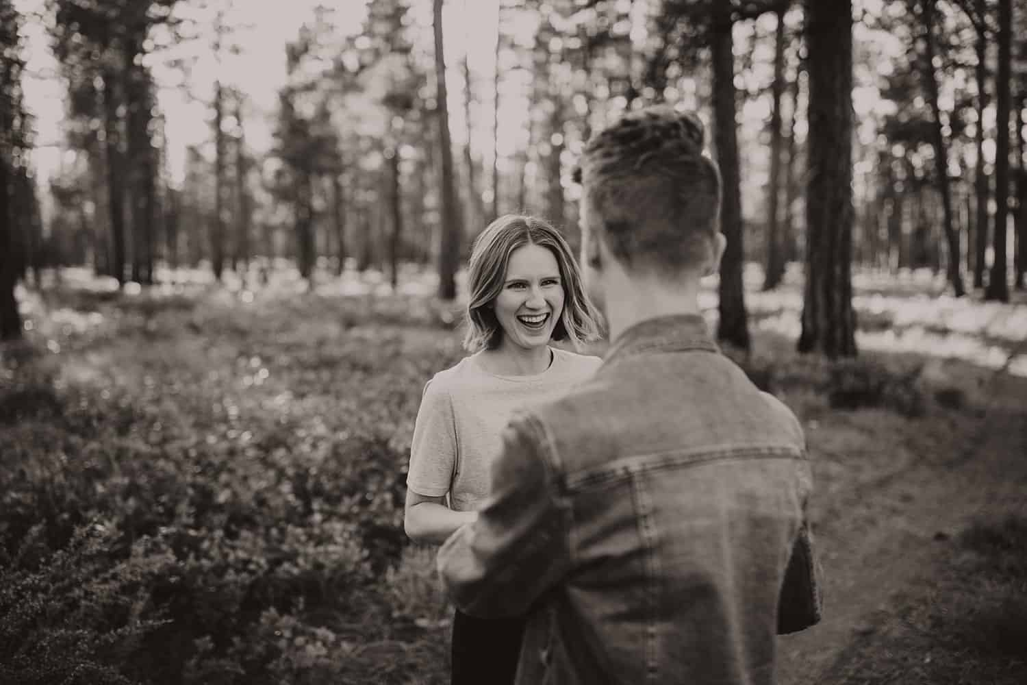 Engaged couple in high desert forest in Central Oregon