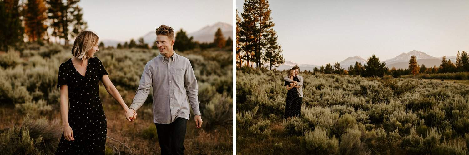 Engaged couple in meadow in Central Oregon with a mountain view